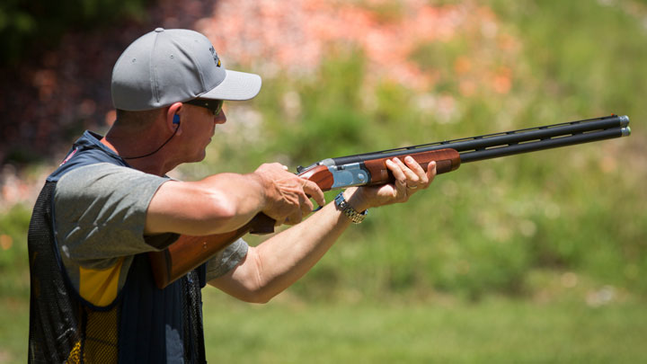male shooter prepares to fire on the trap range